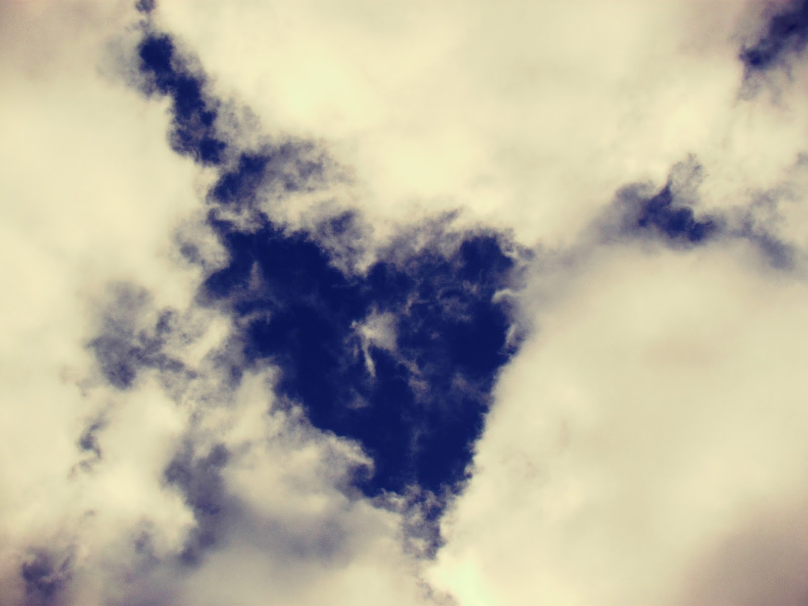 A dark blue sky with heart-shaped clouds in mother nature + atmospheric clouds