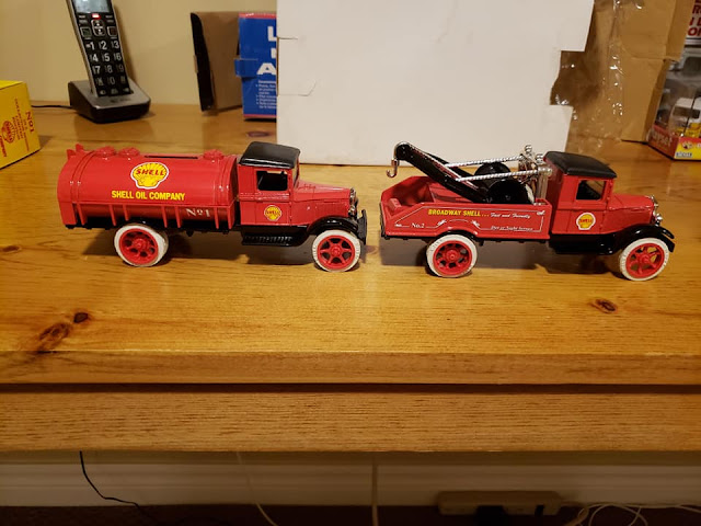 Two Shell Oil collectible metal banks.