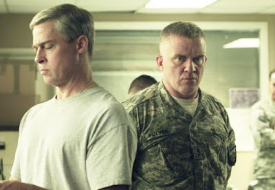 Anthony Michael Hall como Greg Pulver en 'Máquina de guerra'