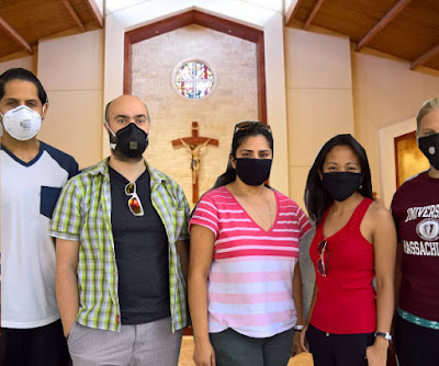 people wearing masks in church photograph