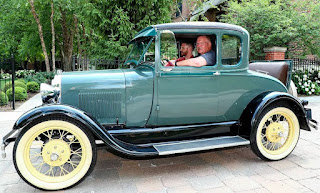 Drew Ann Reid's father Andy with a classic car