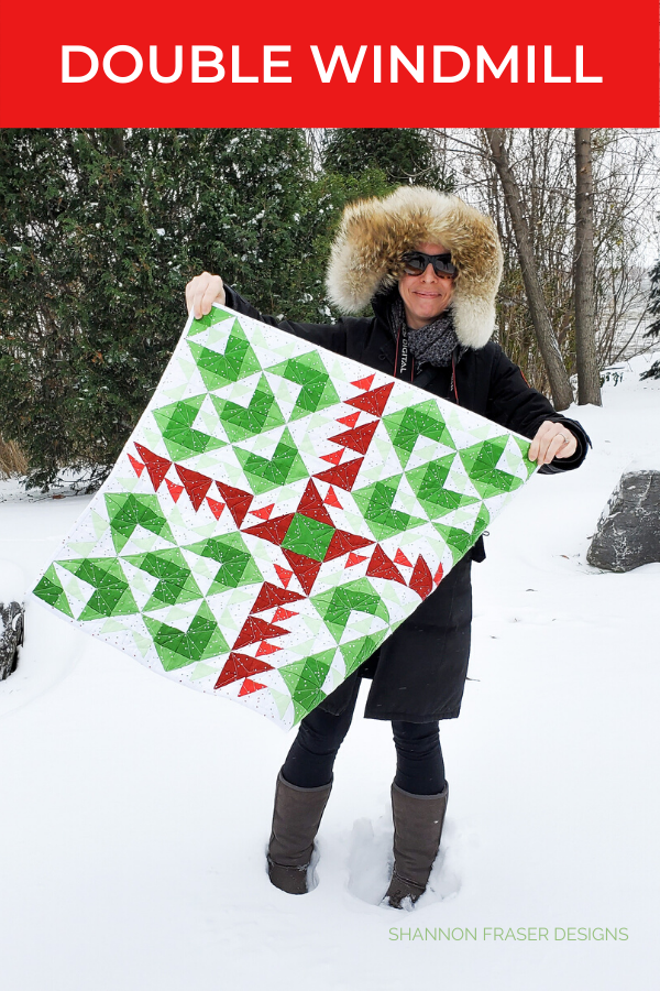 Me holding the Blossom Double Windmill wall hanging | Shannon Fraser Designs #wallhanging #quilts #miniquilt #quilters #modernquilters #quiltsinthewild