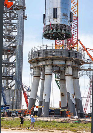 Super Heavy Booster BN4, with all 29 engines, lifted onto launch pad (Source: @Spadre)