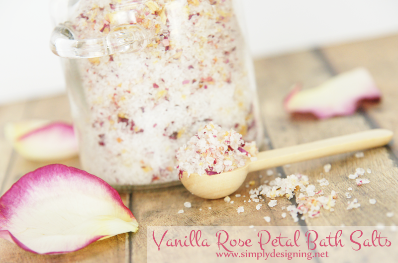 Spoon of bath salts blended mixed with bits of real rose petals and vanilla fragrance