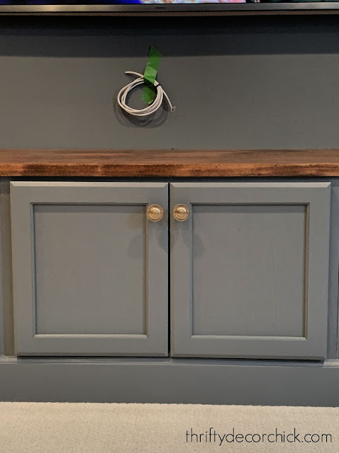 gray bench with brass hardware
