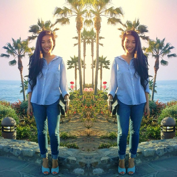 Stephanie Liu of Honey & Silk wearing Madewell shirt, Paige jeans, 3.1 Phillip Lim Cody heels, and vintage purse in Laguna Beach