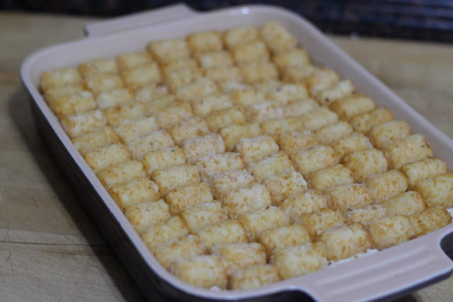 The frozen tater-tots place on top of the casserole filling.
