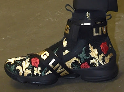 e816e910611 LeBron James arrives at Quicken Loans Arena rocking a new colorway of the  Kith x Nike LeBron 15 Strap in Black with Gold Floral. While having a Black-based  ...