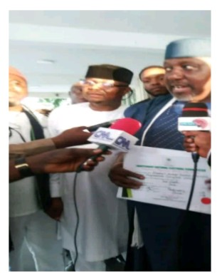 Okorocha receives his Certificate of Return from INEC