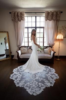 brides lace gown in bridal suite