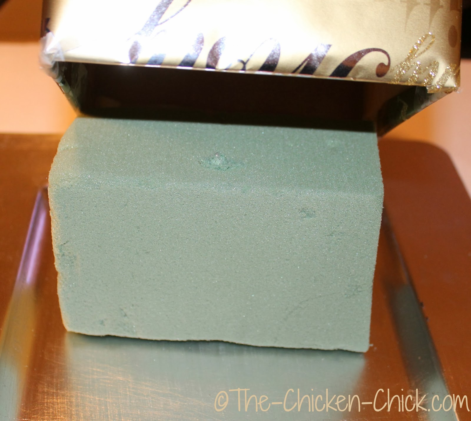 add bottom box to fit snugly over the top of the floral foam on cake base