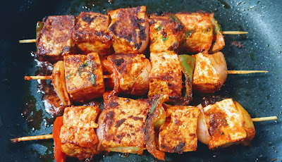Cooked paneer on Tawa for paneer Tikka
