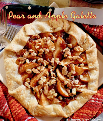 Pear and Apple Galette, a rustic version of a pie featuring fresh pear and apple slices, baked in a pie crust with a hint of apricot and the crunch of walnuts. | Recipe developed by www.BakingInATornado.com | #recipe #dessert