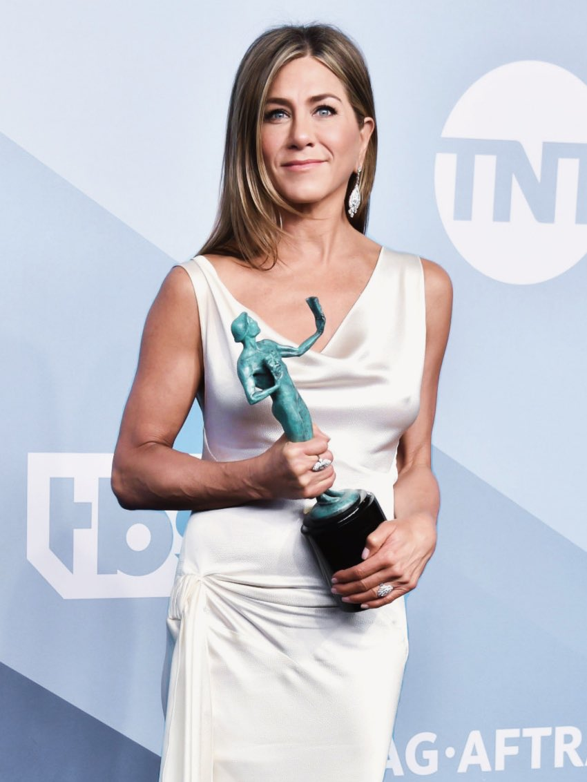 Jennifer Aniston Wears Goddess-Inspired, Clingy White Gown at SAG Awards