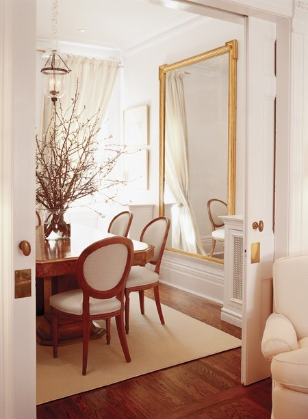 Heir And Space Decorating With Gold Mirrors