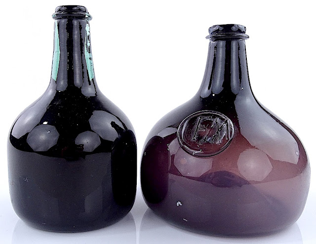 two dark purple Burstow & Hewett glass bottles