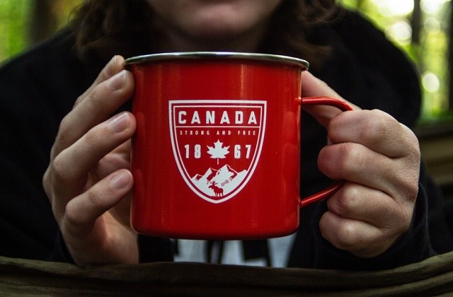 Canada red mug held by woman