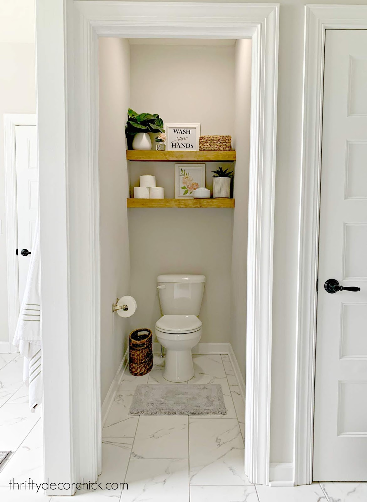 Wood shelves above toilet water closet