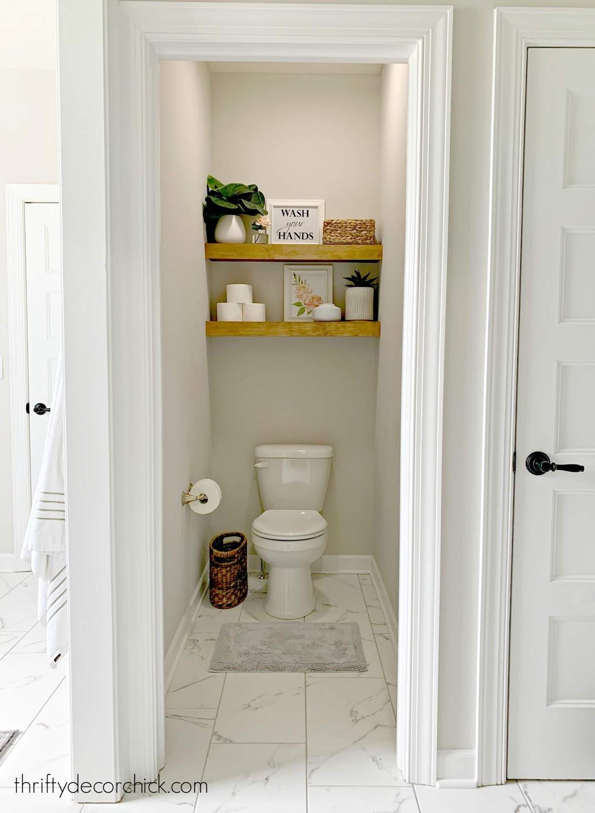 Wood shelves above toilet water closet
