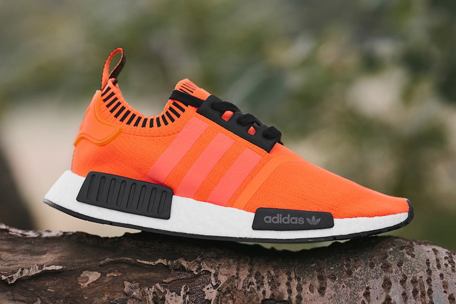 23891d45c9ac size  has joined forces with adidas Originals to launch a new colorway of  the NMD R1 model. Coated in neon orange