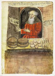 Monjo alemany [ss. XIV-XV] mostrant els seus pans. Llicència Wikipedia Commons.