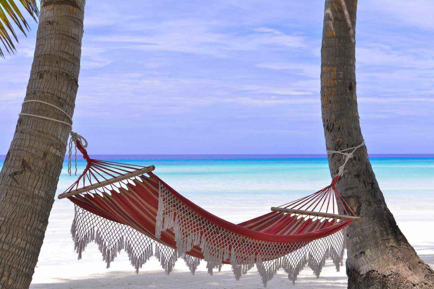hammock on beach in the maldives - best tropical islands to visit