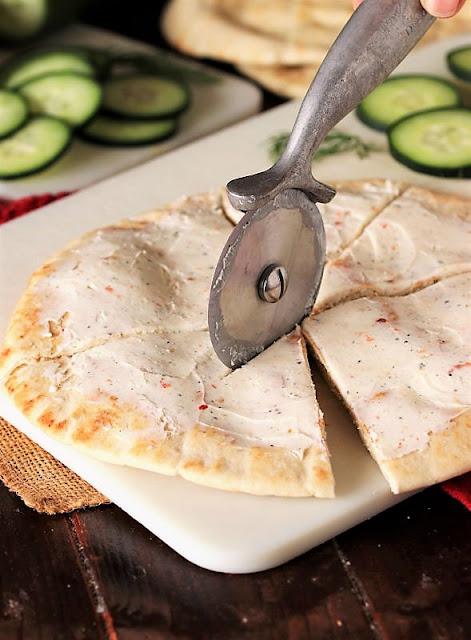 Cutting Cucumber Pita Bites with Pizza Cutter Image