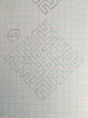 A spiral motif formed from intersecting diagonal lines, drawn in pencil on graph paper