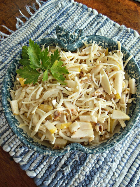 Shredded celery root along with Asian pears in a delicious maple sweetened salad.