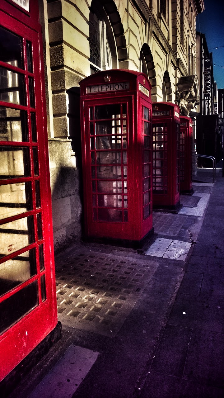 Telephone Boxes: Red Payphones All In A Line