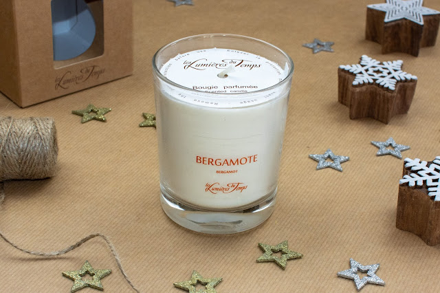cream candle made from vegetable wax in a clear glass pot saying Bergamot on it