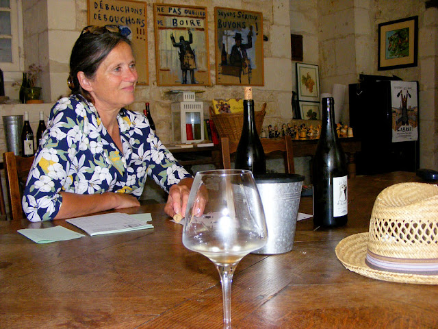 Pascale Plouzeau in her winery's tasting room.  Indre et Loire, France. Photographed by Susan Walter. Tour the Loire Valley with a classic car and a private guide.