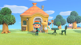 Me in Animal Crossing next to Saharah in front of Anabelle's house