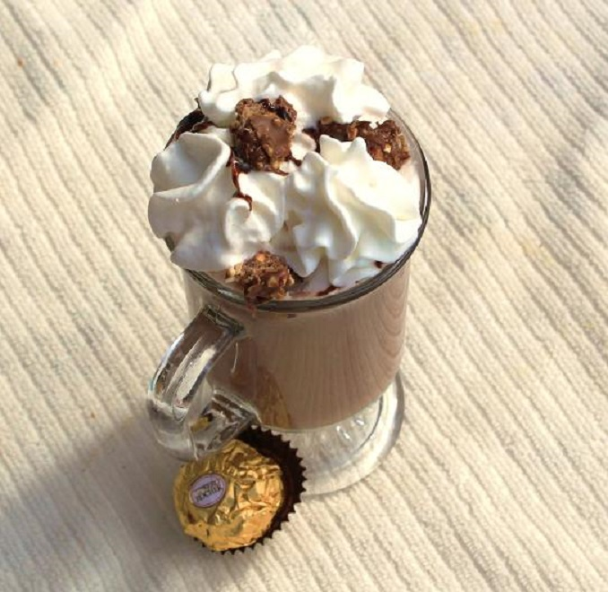 a delicious cup of hot cocoa, Ferraro Rocher candy and whipped cream on top with a Nutella ingredient in the mix!