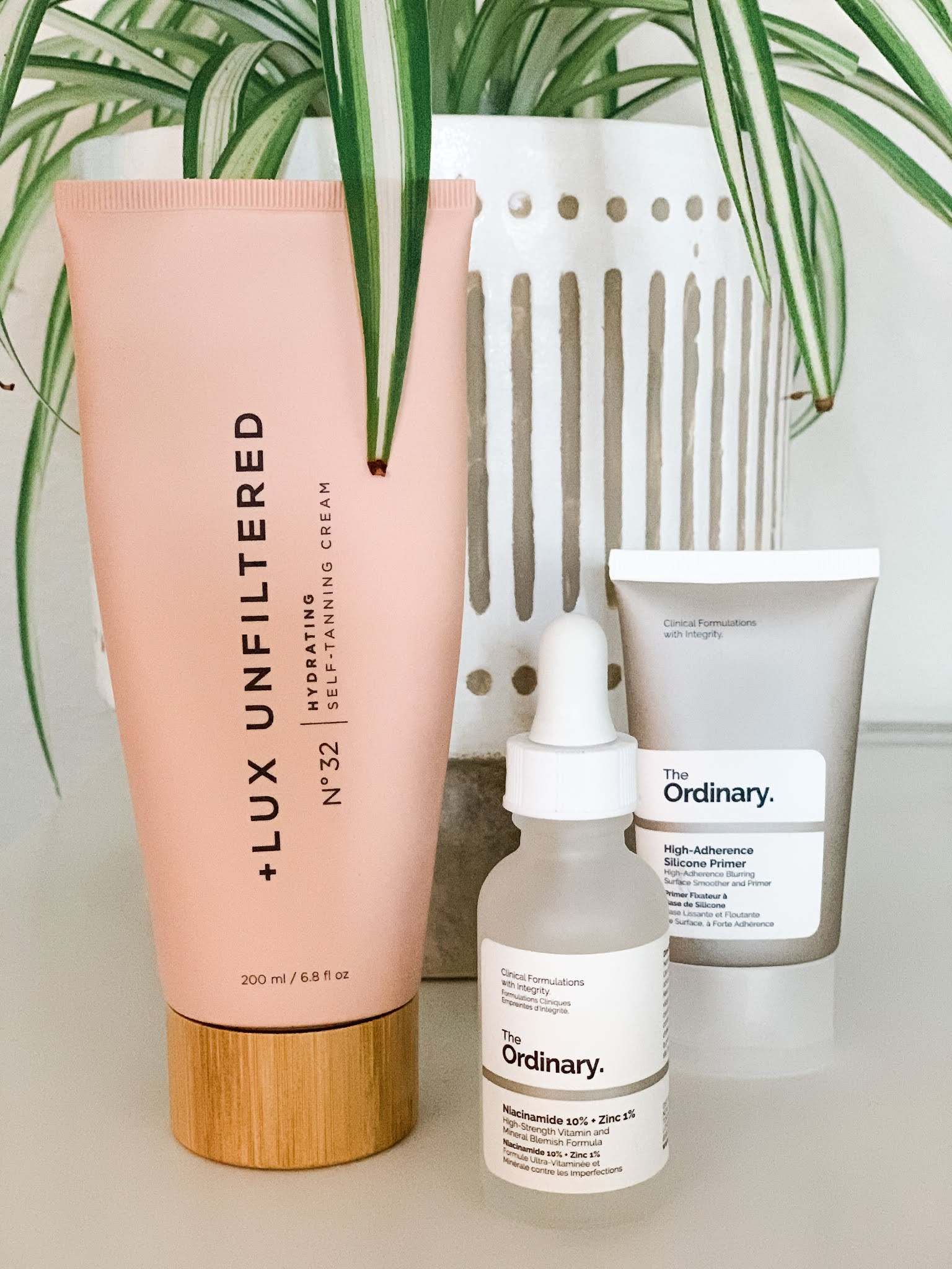 Lux Unfiltered self-tanner and The Ordinary products