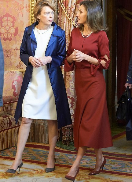 Queen Letizia wore Hugo Boss Vermana A-line wool and cashmere midi skirt and Hugo Boss Burana Silk Blouse