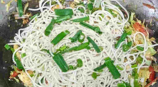 Ading boiled noodles with chopped spring onion with vegetables for chicken hakka noodles recipe