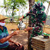 Jalin Tali Persaudaraan, Satgas TMMD 109 Tuangkan Minum untuk Warga