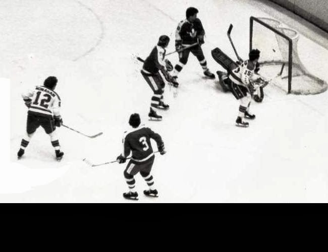 Vs. Toronto: Three Leafs and Hartland Monahan (12) have a wonderful view as Guy Charron scores