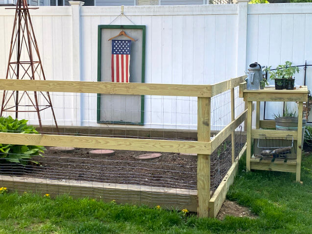 Pressure treated lumber garden fence
