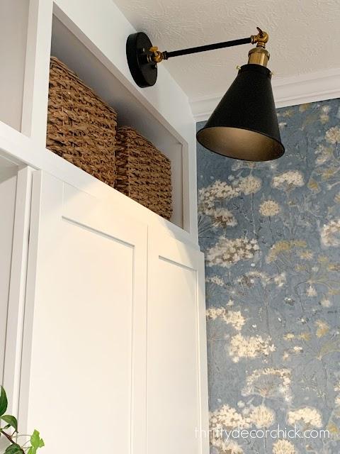 lighting black sconce above cabinets