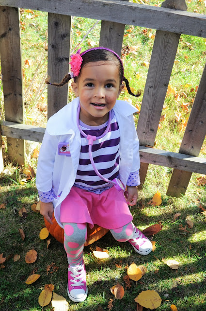 Toddler in DIY Doc McStuffins Costume