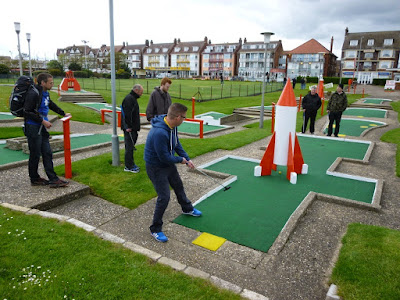 Playing the Arnold Palmer Putting Course in Skegness on National Miniature Golf Day during a minigolf weekender in 2015