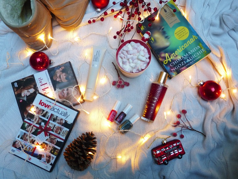 waiting for christmas, ursula blanket, cosy evening, essie nail polish, Peter's famous classic home boots, americana by Chimmanda Ngozi Adichie book, marks and spencer christmas room spray, london bus ornament, red baubles, fairy lights, the holiday, love actually, ecoya hand cream
