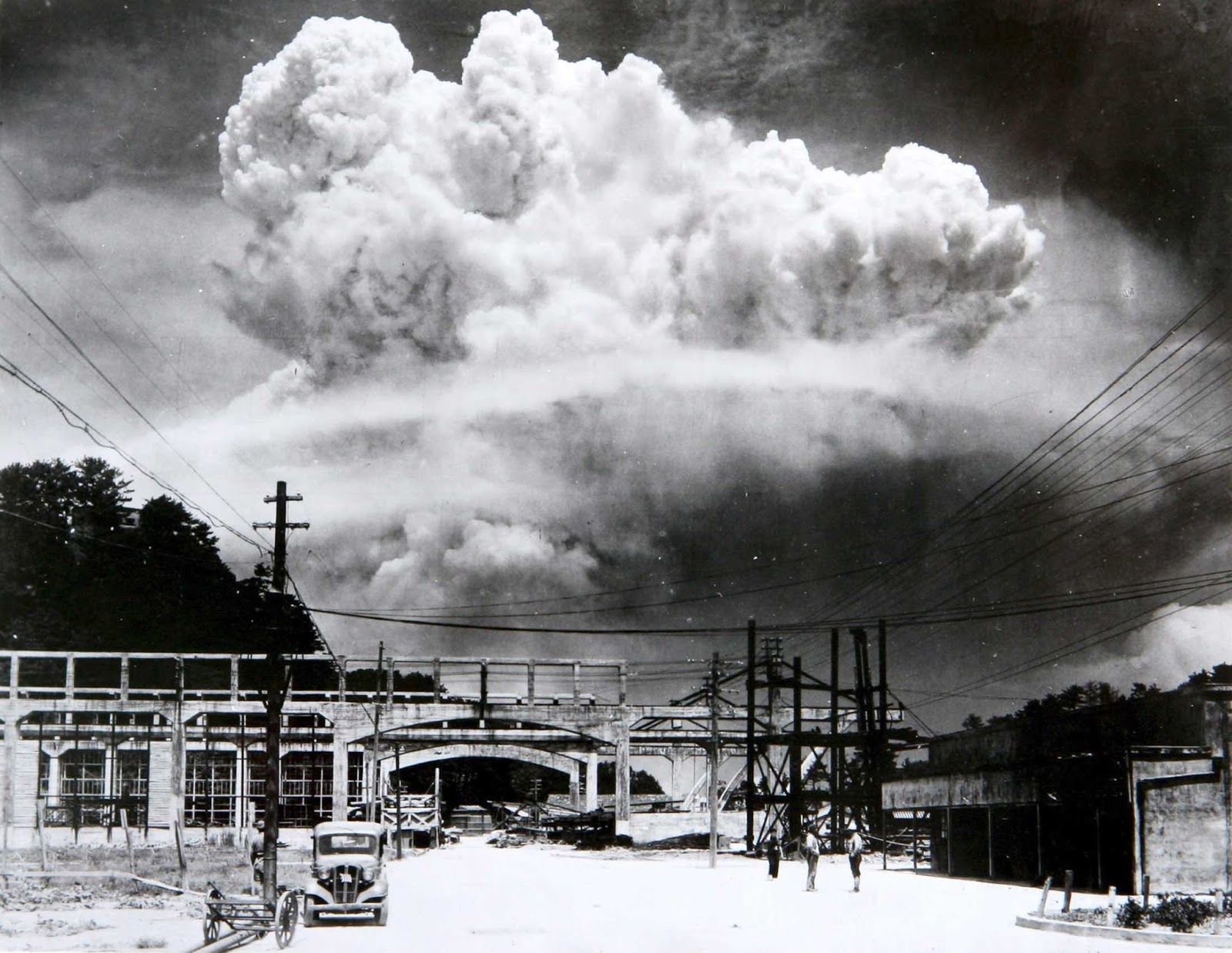 The rising mushroom cloud over Nagasaki, a few minutes after the nuclear bomb was detonated, August 9, 1945. Picture taken from Koyagi-jima, 5 miles from the center of Nagasaki.