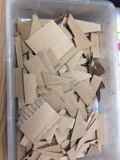 box of precut cardboard shapes for art class for special needs students