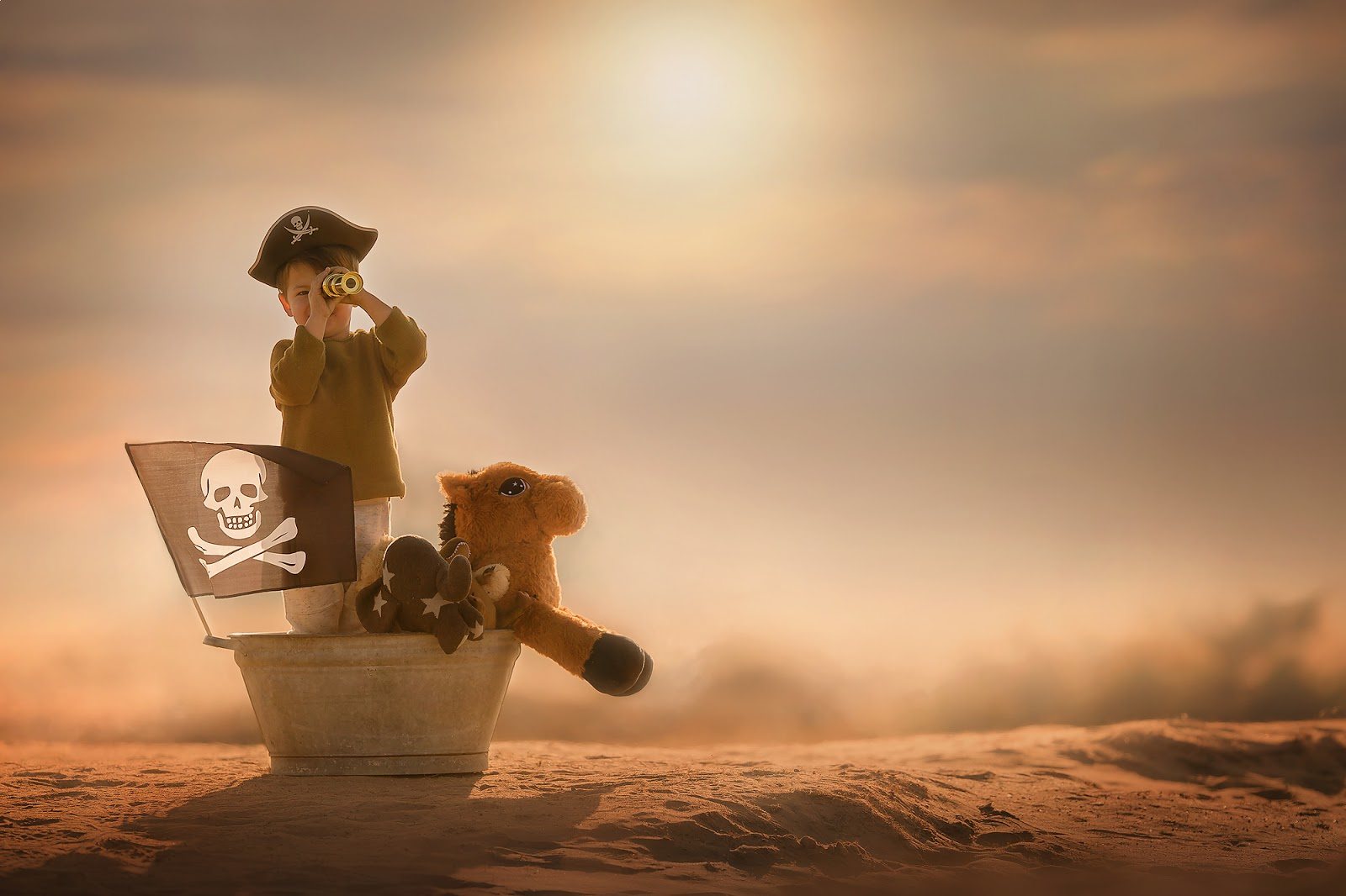 Canon 5D mark III Color image of a little boy pirate standing in a bath tub with toy animals and binoculairs in the desert during sunset by Willie Kers copy