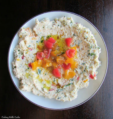 small bowl of feta mixed with herbs and tomatoes