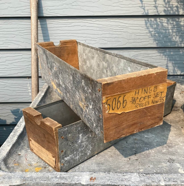 Photo of two galvanized and wood hardware bins/drawers