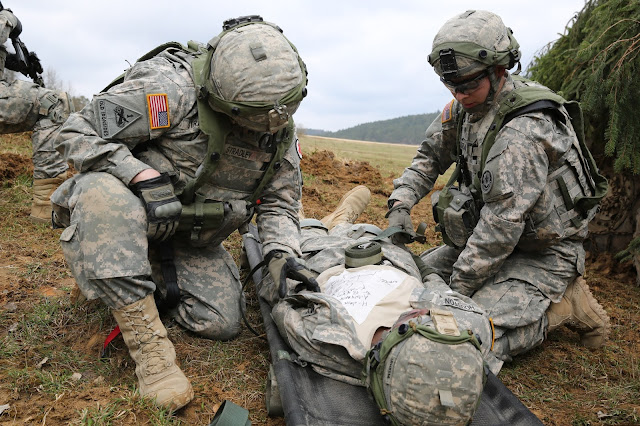 Soldiers assigned to Bravo Troop, 1st Squadron, 2nd Cavalry Division strap a Soldier with simulated wounds to a litter during a 2015 exercise at the U.S. Army's Joint Multinational Readiness Center in Hohenfels, Germany, April 12, 2015.  Lessons learned on the battlefield are being applied today in the U.S., such as how to stop life-threatening bleeding to save lives.   (photo by Spc. Brian Chaney, Viper Combat Camera USAREUR)